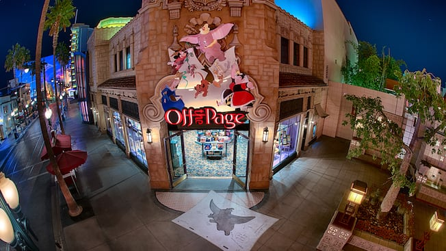 Vibrant lights illuminate the exterior of Off the Page as Disney characters cascade down its signage