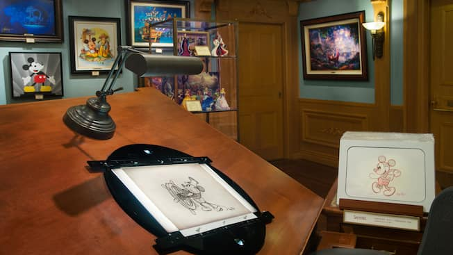 A sketch of Mickey Mouse from Steamboat Willie showcased on an artist's easel inside Disneyana