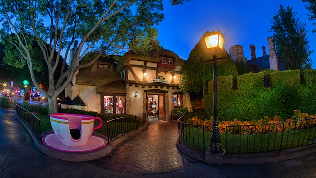 A whimsical tea cup leading the way to the entrance of Mad Hatter in Fantasyland at Disneyland Park