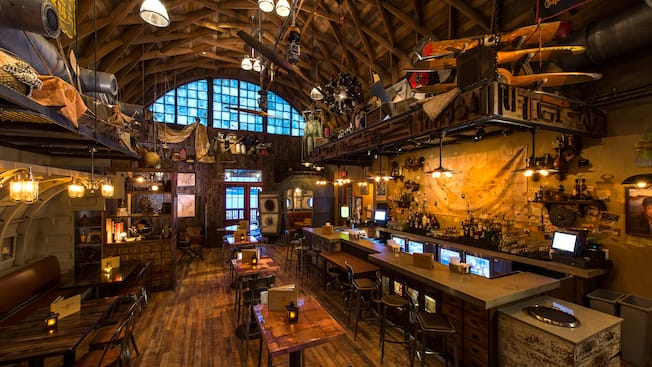 The interior dining area and bar of Jock Lindsey's Hangar Bar