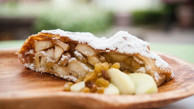 Cross section of apple strudel with golden raisins dusted with powered sugar