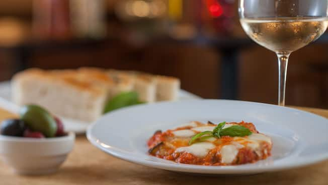 Baked zucchini appetizer topped with pomodoro, mozzarella and parmesan