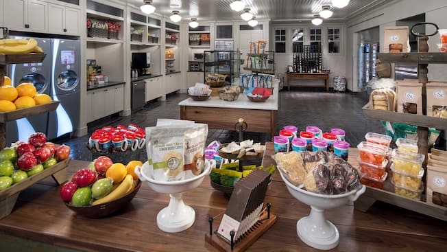 A room displaying food and beverage options including packaged desserts, fruit, soda and more