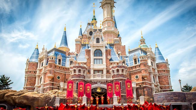 A rousing daytime performance in front of Enchanted Storybook Castle at Shanghai Disneyland in China
