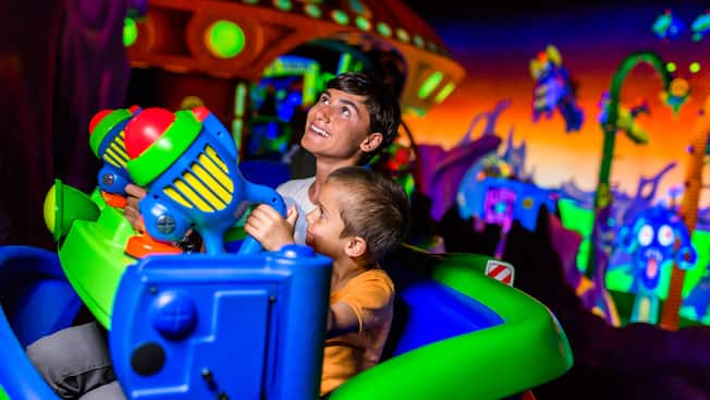 A teenager and his younger brother take their mission to help Buzz Lightyear seriously