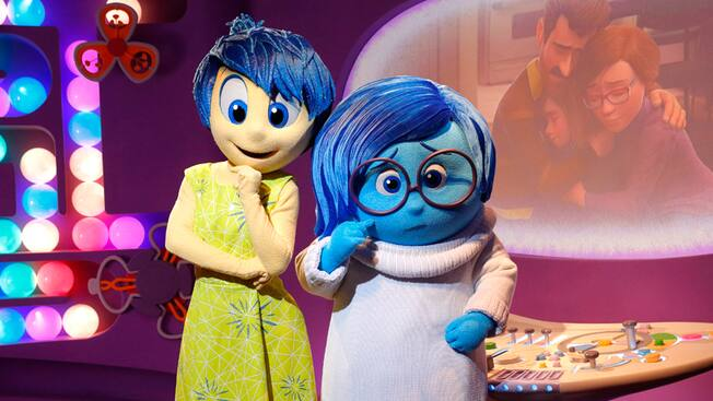 Joy and Sadness from the Disney·Pixar film 'Inside Out' pose during a Character Greeting experience