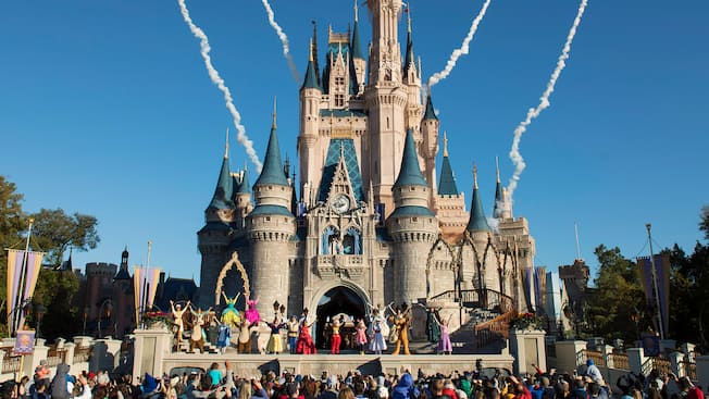 Mickey, Minnie and many other Disney Characters welcome the day's first Guests to Magic Kingdom park