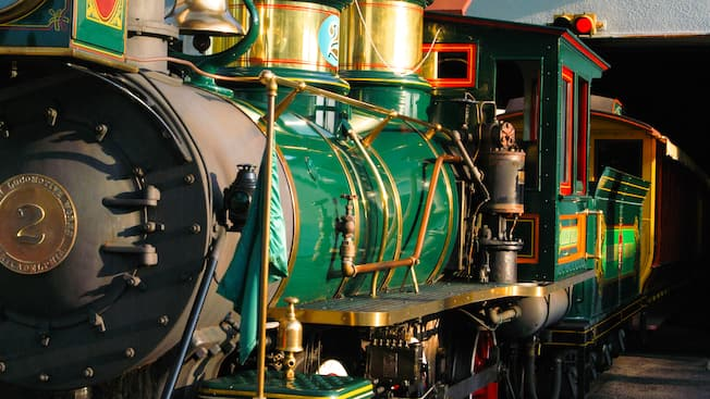 A shiny green antique steam locomotive