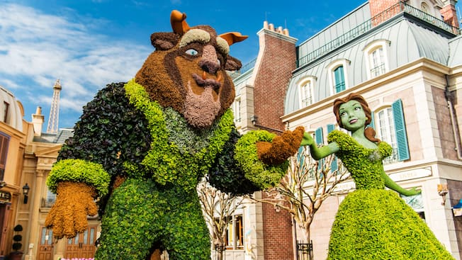 https://cdn1.parksmedia.wdprapps.disney.com/resize/mwImage/1/630/354/75/dam/wdpro-assets/parks-and-tickets/tours-and-experiences/epcot-international-flower-and-garden-festival/flower-garden-beauty-beast-topiary-16x9.jpg?1617200615840