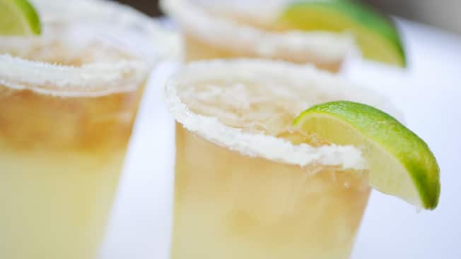 A trio of margaritas on the rocks with salt and limes on the rims