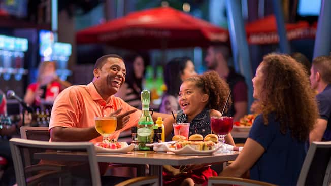 A father and his young daughter enjoy food and beverages at the Splitsville Dining Room