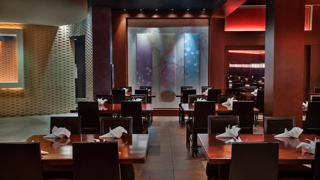 Tables and chairs in the elegant Japanese-themed dining room at Tokyo Dining