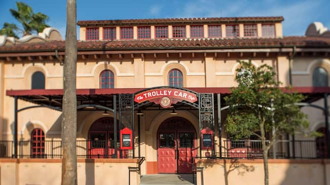 Signage for The Trolley Car Café adorning the entry to the location's Spanish Colonial architecture