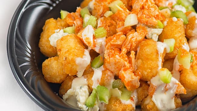 Tater tots topped with chicken, cheese and celery