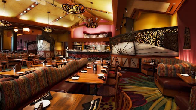 Banquette booths, tables and chairs in dining room at Kona Café