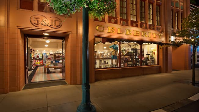 Storefront of Celebrity 5 & 10 at Disney's Hollywood Studios, lit up at night