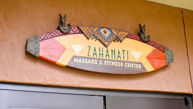 A sign above a set of doors reads: Zahanati Massage & Fitness Center