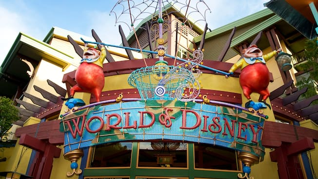A sign with Tweedle Dee and Tweedle Dum above words that reads World of Disney