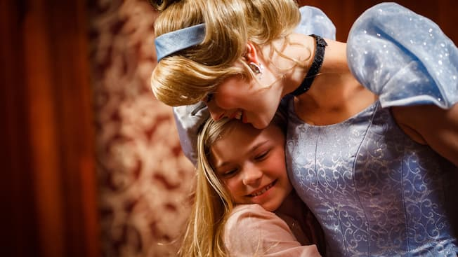Cinderella hugs a little girl