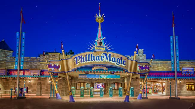 A spotlighted theater with a sign that reads Mickey's PhilharMagic