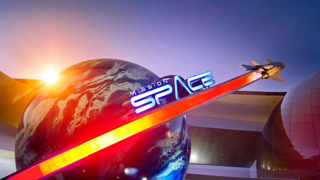 A logo outside a building that reads Mission Space, with a rocket ship and a globe