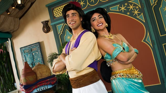 Aladdin and Jasmine stand back to back