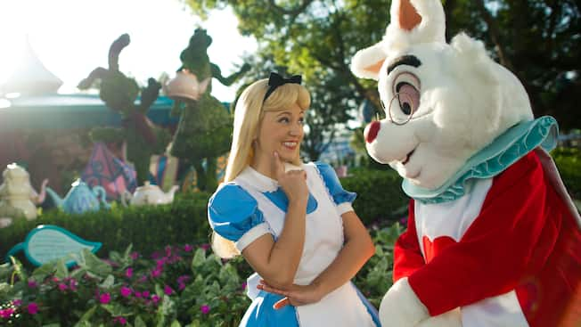 Alice stands next to the White Rabbit