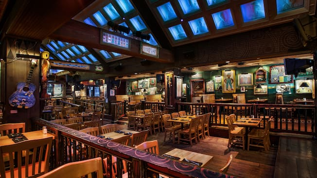 The inside of The House of Blues Restaurant with tables, chairs and pictures covering the walls