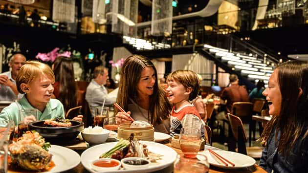 A family eating at a dinner table in Morimoto Asia