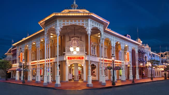 A two story store with a sign that says Emporium, Main Street USA