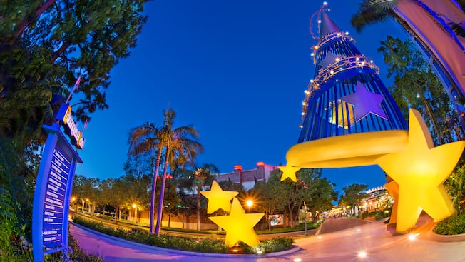 The Sorcerer's Hat sculpture surrounded by stars lights the path to the Downtown Disney District