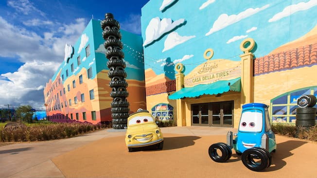 Life-sized Luigi and Guido from Disney and Pixar's Cars, parked outside the Cars Family Suites