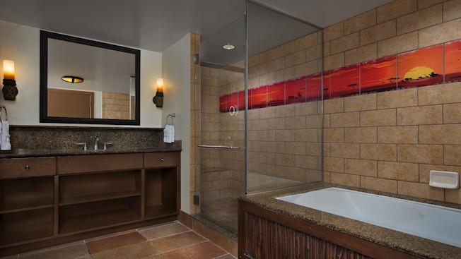 Um banheiro com chuveiro e banheira separados, azulejo decorativo com tema africano