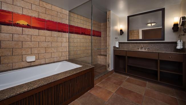 Um banheiro com chuveiro e banheira separados e azulejo decorativo com tema africano