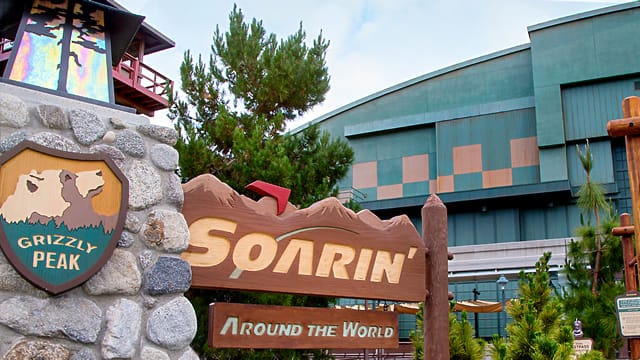 Soarin' Around the World next to a sign with a bear on it