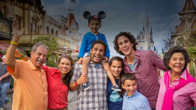 A multi generational family posing for a family together on Main Street, U.S.A. at Magic Kingdom park