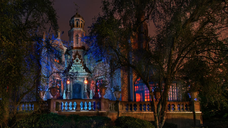 The Haunted Mansion attraction, with special Halloween themed lighting, beckons guests to Magic Kingdom park for a frightfully fun night