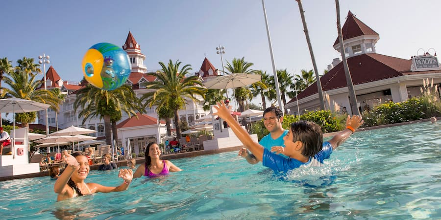 A family of 4 playing in a pool at Disney s Grand Floridian Resort ... fa7a717d8d