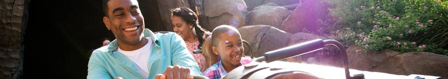 A family rides the Seven Dwarfs Mine Train attraction