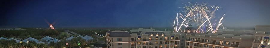 Fireworks bursting in the sky above Disney's Riviera Resort at night