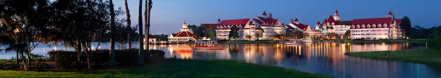 Disney's Grand Floridian Resort & Spa, a stately Victorian beach resort, on the shore of a lake lined with palm trees