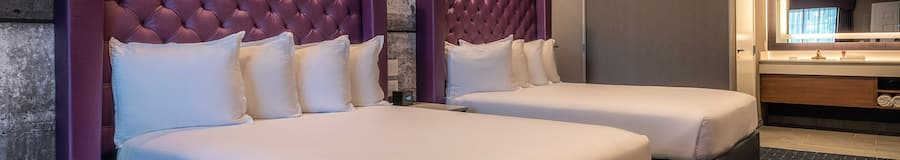 Two queen beds with headboards