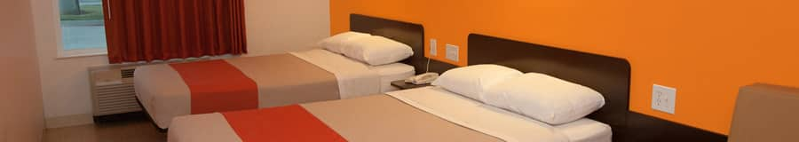 Two platform double beds with headboards