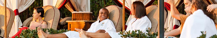 Couples relax in the luxury and comfort of rented private poolside cabanas