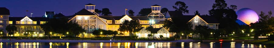 A night view of Disney's Beach Club Resort on the shore of Crescent Lake