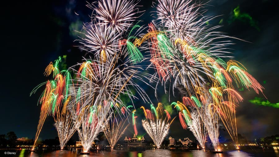 Fireworks bursting over World Showcase Lagoon at Epcot