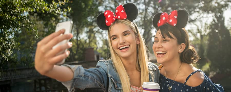 Wearing Minnie Ears, 2 Guests take a selfie