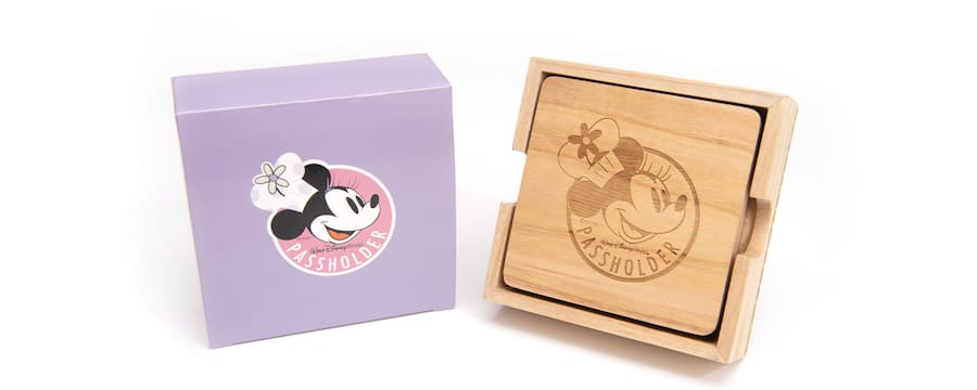A gift box next to a collection of wooden coasters featuring Chef Minnie