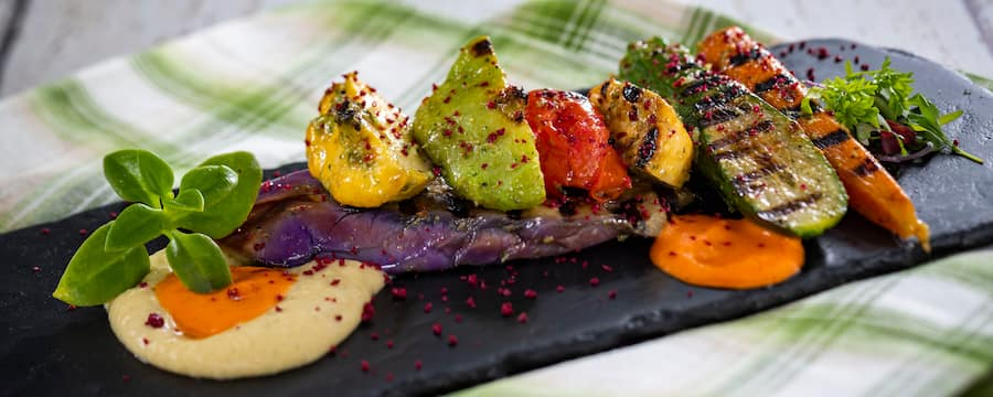 A colorful spread of grilled vegetables on a serving board