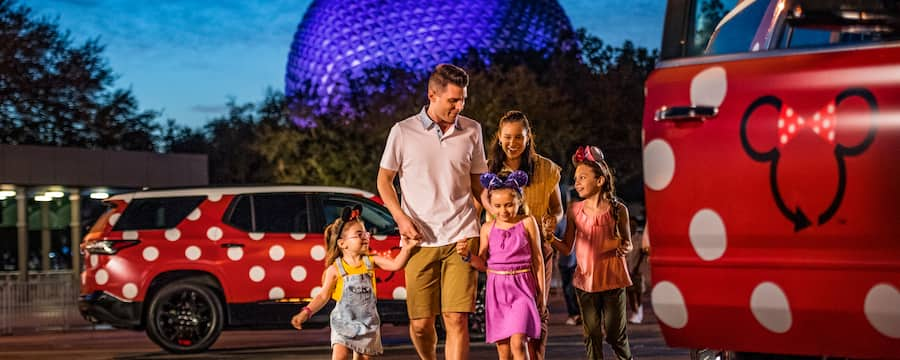 A family arrives at Epcot, leaving behind their Minnie Van service vehicle